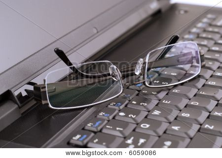 Business Image Of Spectacles On Laptop Keyboard