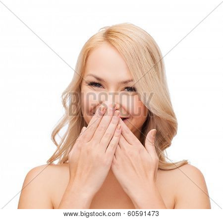 spa, health and beauty concept - beautiful woman covering her mouth