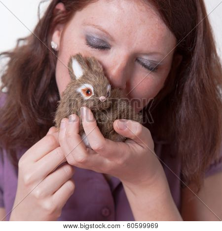 young women kissing a plush toy bunny at easter