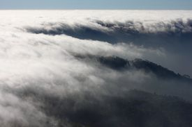 Mist Sea Of Fog Clouds And The Mountain