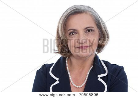 Isolated Portrait Of A Satisfied Senior Female Business Woman.