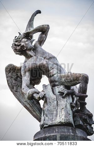 fallen angel, devil figure, bronze sculpture with demonic gargoyles and monsters