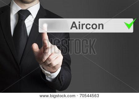 Businessman Pushing Button Aircon Checked