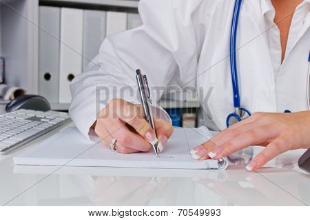 a doctor in the surgery performs administrative work. bureaucracy in the doctor's office.