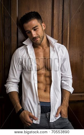 Sexy Handsome Young Man Standing In White Open Shirt With A Smile