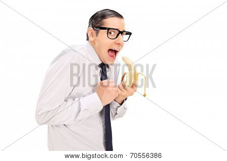 Scared man with glasses eating a banana isolated on white background