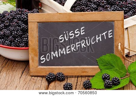 Slate Blackboard With The Words: Suesse Sommerfruechte