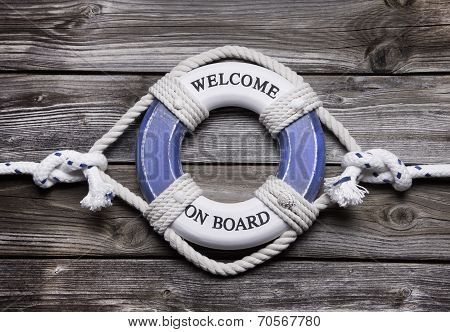 Wooden Background With Blue And White Life Preserver For Maritime Concepts.