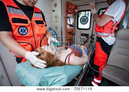 Unconscious Woman And Working Paramedics