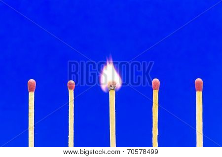 Burning Match Setting On Blue Background For Ideas And Inspiration