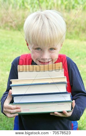 Little Child Carrying Lots Of Big Heavy School Books