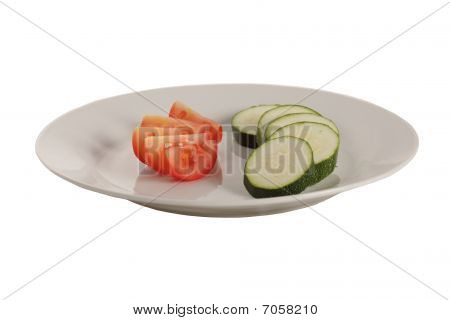 Slices Of Courgette And Tomato On The Plate