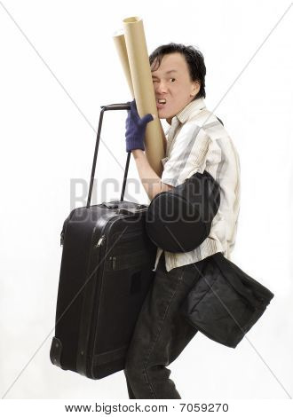 man loading excess baggage