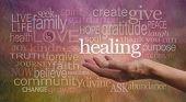 Healer's outstretched open hand surrounded by random wise healing words on a rustic stone effect background poster