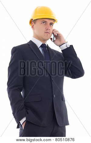 Young Handsome Business Man In Yellow Builder's Helmet Talking By Phone Isolated On White