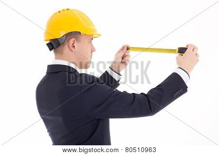 Back View Of Business Man Or Architect In Yellow Builder's Helmet With Measure Tape Isolated On Whit