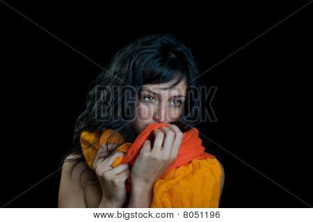 Innocent woman on black background.