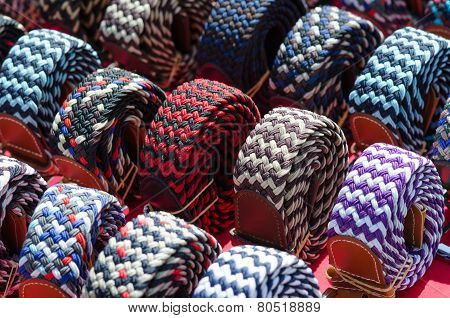 Italian Textile Waistbands On A Desk Of A Market In Milan