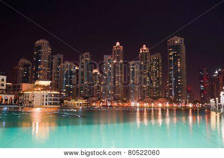 DUBAI - OCTOBER 13: area near the Dubai Fountain on October 13, 2014 in Dubai, UAE. The Dubai Fountain is the world's largest choreographed fountain system set on the 30-acre manmade Burj Khalifa Lake