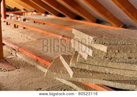 Mineral wool stack on construction site - thermal insulation of a house poster