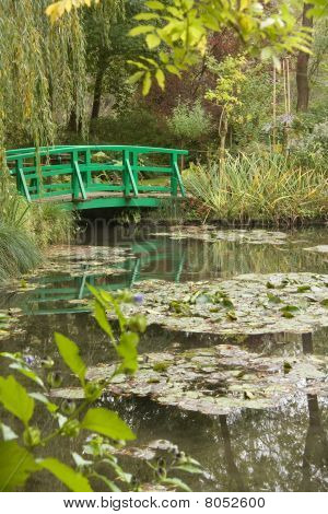 Home of artist Claude Monet showing the famous water lillies and Japanese bridge poster