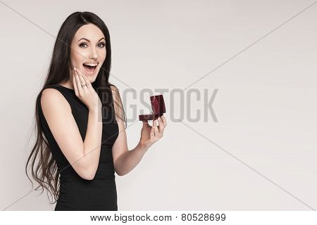 Surpriced Woman Holding Jewelry Box