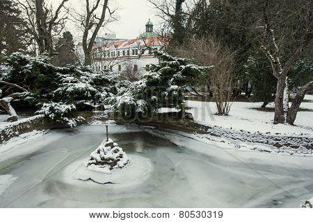 Topolcianky Castle With Frozen Lake In Winter