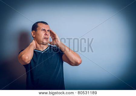 male of European appearance brunet put his hands on head