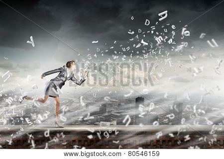 Young businesswoman in suit running in a hurry