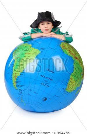 Boy In Historical Dress Leans On Inflatable Globe Chin On Hands  Isolated On White