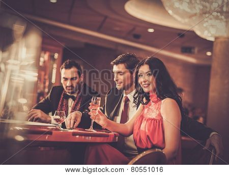 People behind poker table in a casino