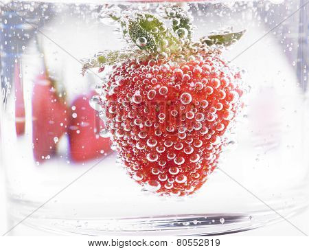 Fresh Strawberry in Mineral water with boobles poster