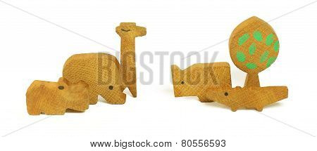 Six Wooden Toys In The Form Of A Tree And The African Animals
