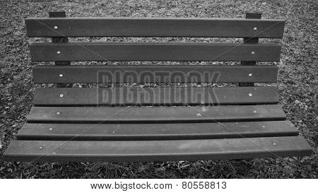 Wooden lath park bench in black and white