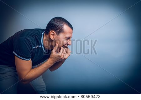 man of European appearance brunet shoved his fingers