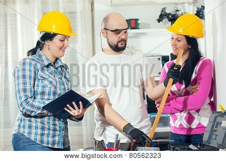 Craftsman and two craftswoman, selective focus