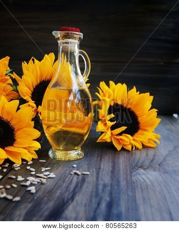 Sunflowers, sunflower seeds and a bottle of