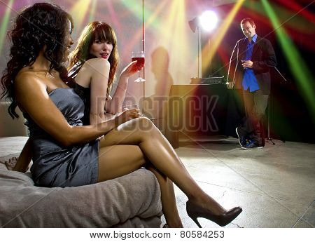 Women Attracting Attention at Nightclub