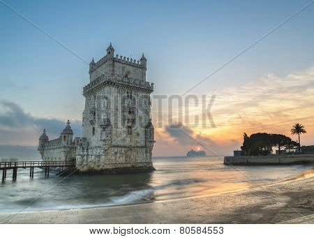 Lisbon, Portugal, Europe - view of the belem tower with a luxury cruise ship at sunset - long exposure