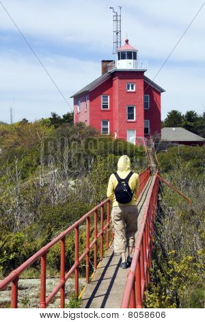 Tourist By Marquette Harbor Lighthouse