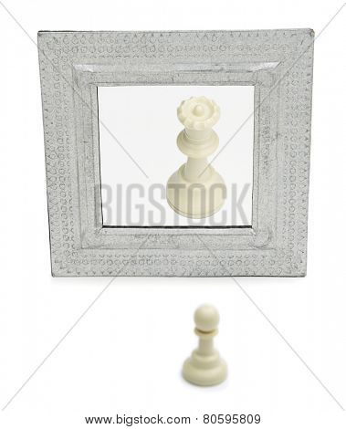 Narcissistic personality disorder concept - Chess pawn imaging itself as a queen isolated on white background.