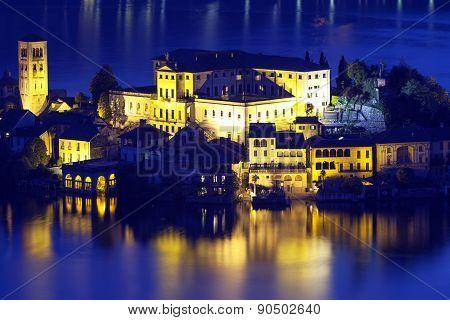 Orta San Giulio island, night view. Color image