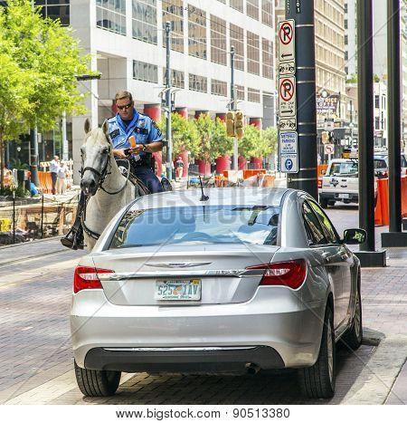 Policeman On Horse Checks Correct Parking