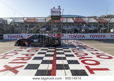 Long Beach, CA - Apr 18, 2015:  The Konica Minolta Chevrolet crosses the finish line at the Tequila Patron Sports Car Racing Showcase at Long Beach Grand Prix in Long Beach, CA.