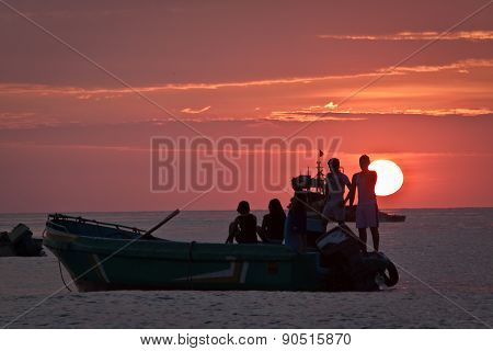 Beautiful landscape view of floating fishing boat with amazing sunset in the background, Manabi, Ecu
