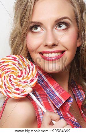 Nice young girl with lolipop
