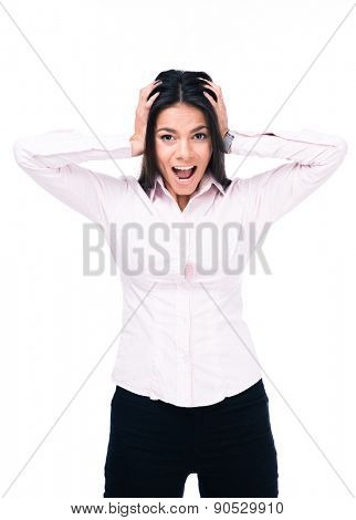 Young businesswoman shouting and covering her ears with hands. Isolated on a white background. Looking at camera