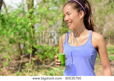 Green detox smoothie - woman drinking vegetable smoothie after fitness running workout on summer day. Fitness and healthy lifestyle concept with beautiful fit mixed race Asian Caucasian model. poster
