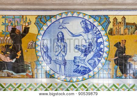 S. Bento da Porta Aberta, Portugal. April 06, 2015: Baptism of Jesus. Crypt tiles showing Bible and St Benedict life. Pope Francis raised the Sanctuary to Basilica in the 400th anniversary, March 21st