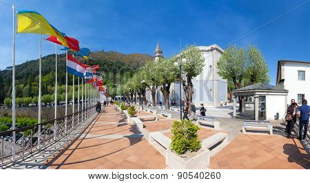 Sao Bento da Porta Aberta, Portugal. April 06, 2015: World flags around the Basilica. 2nd most visited sanctuary in Portugal. Pope Francis raised it to Basilica in the 400th anniversary in March, 21st
